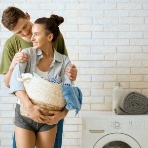 loving couple is doing laundry